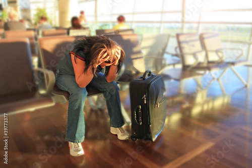 Fotografie, Tablou  Depressed woman awaiting for plane with delay