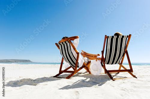 summer relaxing beach couple Canvas Print
