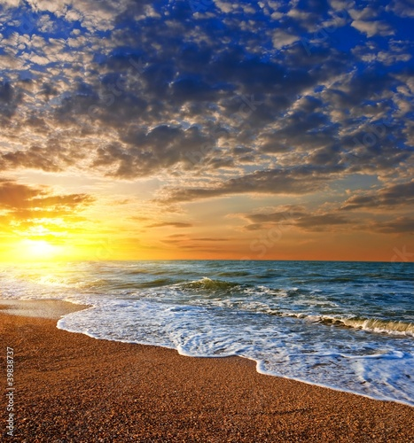 Foto auf Gartenposter Strand dramatic sunset on a sea coast