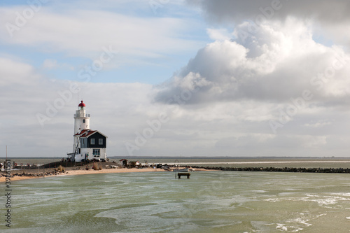 Fotobehang Paarden Lighthouse in Dutch Marken