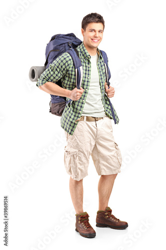 Fotografie, Obraz  Full length portrait of a hiker with backpack posing