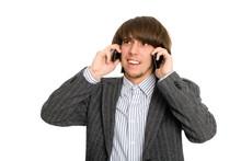 Stockbroker Talking On Two Mobile