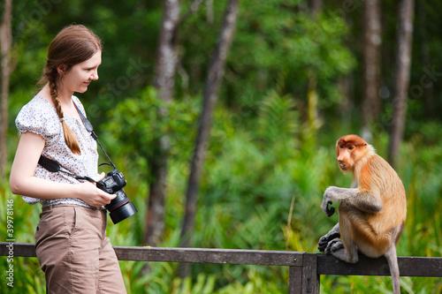 Foto op Plexiglas Aap Female photographer and proboscis monkey