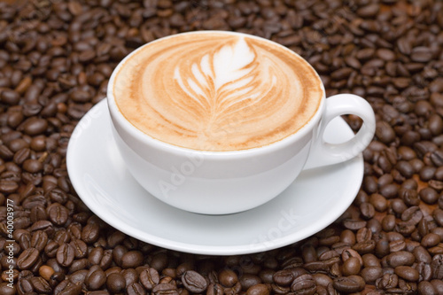 Fototapety, obrazy: Coffee cup with coffee beans background