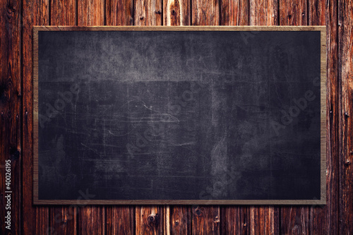 Foto  Blackboard on wooden Wall