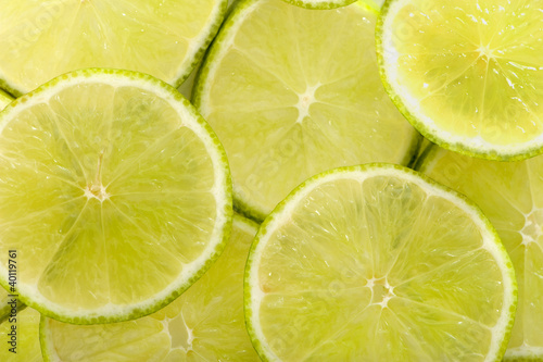 Aluminium Prints Slices of fruit Limette in Scheiben