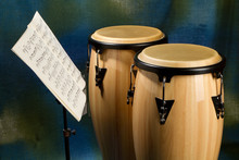 Two Congas On Colored Backgrou...