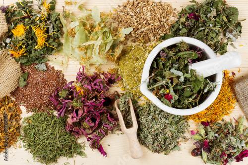 Photo  healing herbs on wooden table, herbal medicine