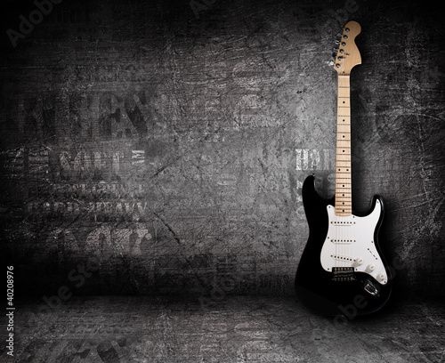 Fotografie, Obraz  Electric guitar and the wall