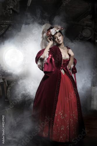 Obraz Beauty woman wearing old fashioned dress - fototapety do salonu
