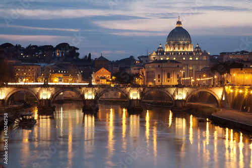 Poster Rome Rome - Angels bridge and St. Peter s basilica in evening