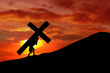 Leinwandbild Motiv Christian background - man carrying a cross up hill