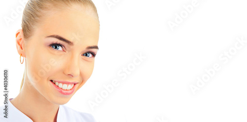 Valokuva  Portrait of a happy young female doctor on white background