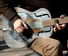 Steel Blues Guitar Being Played