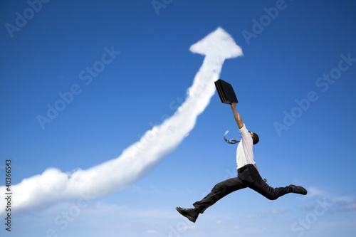 Photo  jumping businessman with business growing graph  cloud