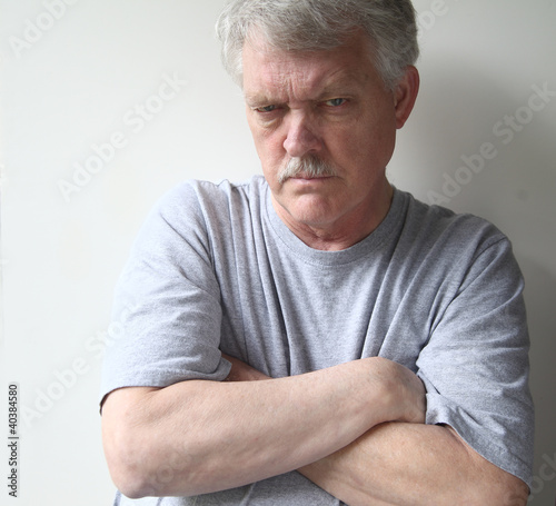 Fotografie, Obraz  angry older man with his arms crossed