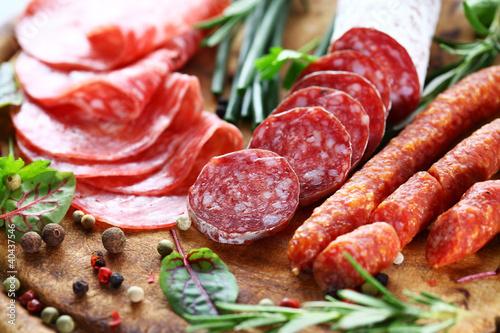 Fototapeta Italian ham and salami with herbs obraz
