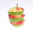 A sliced green and red apple isolated