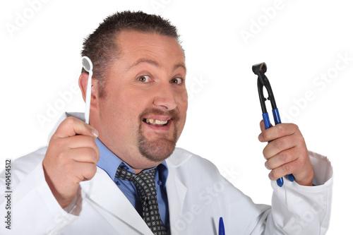 Fényképezés  A dentist with his tools