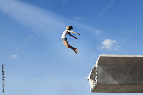Woman jumping off the bridge - Buy this stock photo and explore