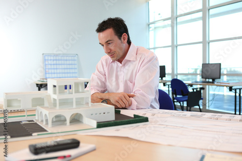 Fotografia, Obraz  Architect with a model of a building
