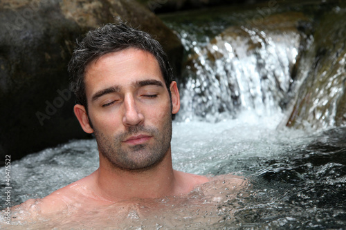 Deurstickers Akt Closeup of man relaxing in natural river spa