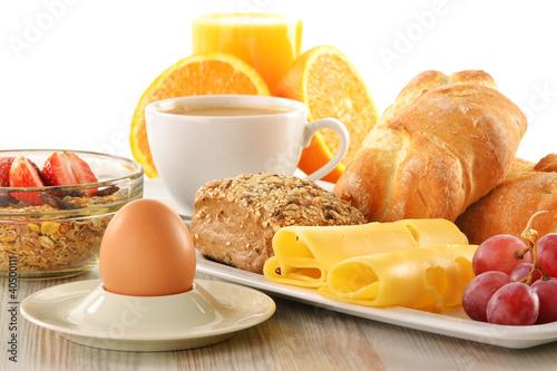 Fotografie, Obraz  Breakfast with coffee, rolls, egg, orange juice, muesli and chee