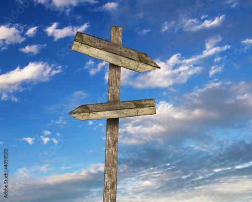 Blank road signs against blue sky Canvas Print