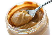 An Open Jar Of Peanut Butter W...