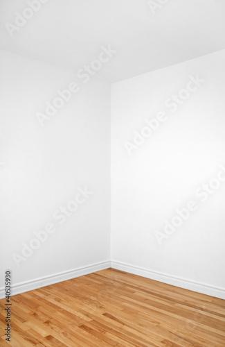 Fototapeta Empty corner of a room with wooden floor obraz