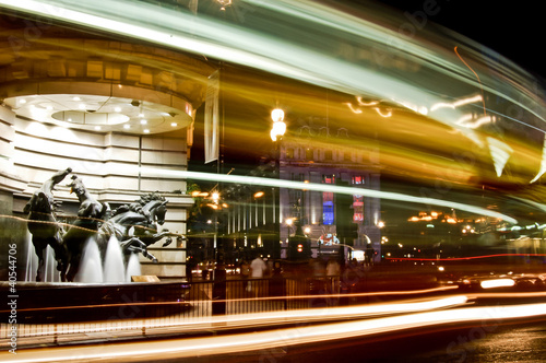Horses statue and street traffic at piccadilly circus by night Canvas Print