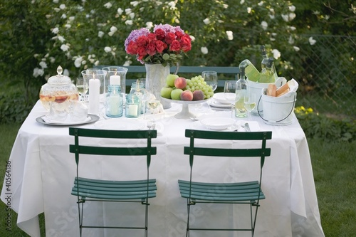 Table laid out of doors for a garden party