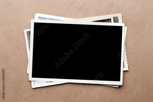 Obraz Stack of old photos on gray cardboard background - fototapety do salonu