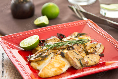 Photo  Grilled Dory fish with sautéed mushroom