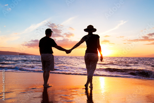 Fototapeta Senior Couple Enjoying Sunset at the Beach obraz na płótnie