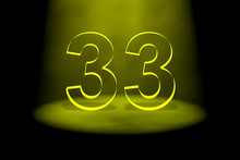 Number 33 Illuminated With Yellow Light
