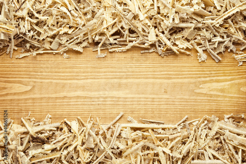 Fotografie, Obraz  Wooden sawdust and shavings background with space for text