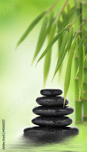 Okleiny na drzwi kamienie  stacked-massage-stones-and-bamboo-design