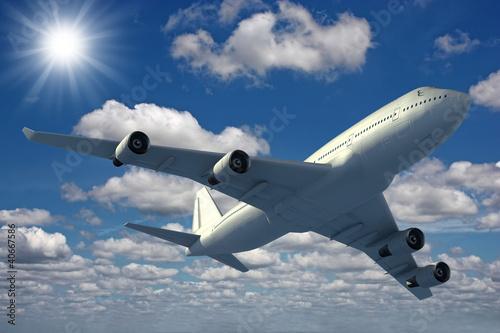 Fototapeta krajobraz   samolot-latajacy-na-niebieskim-niebie