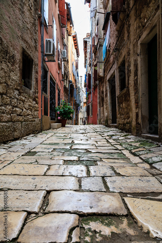 Photo Stands Narrow alley Narrow Street in the City of Rovinj, Croatia
