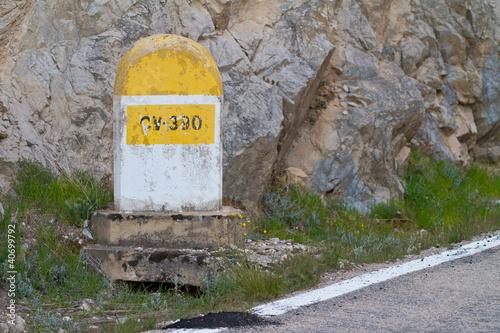 Milestone in the mountains Plakat
