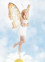 Young Blond Woman As Butterfly On Spring Daisy
