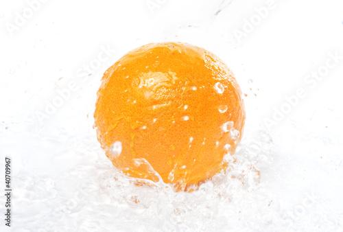 Garden Poster Splashing water orange in spray of pure water