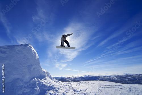 Fotografie, Obraz  Amateur snowboarder making a grab in big air jump.
