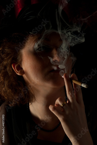 Fototapety, obrazy: Smoking woman in night