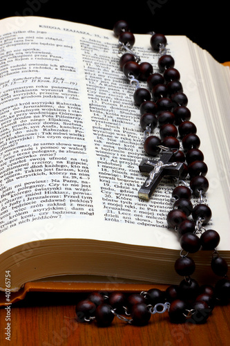 Christian Holy Bible with Crucifix on rosary