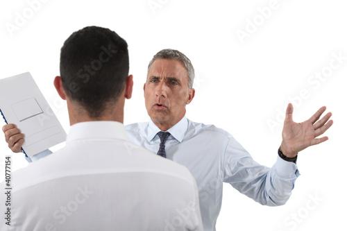 Fotografie, Obraz  Man yelling at his assistant