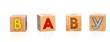 "children's alphabet blocks spelling the word ""BABY"" on a white b"
