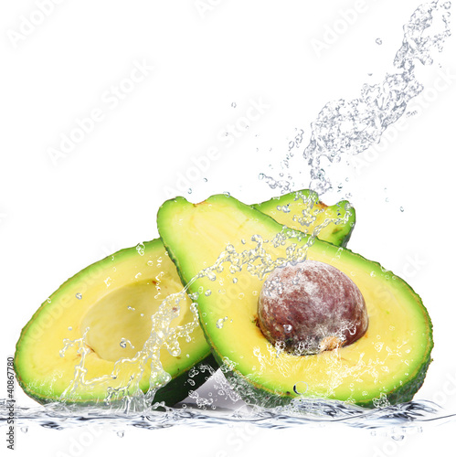 Foto op Canvas Opspattend water avocado splash