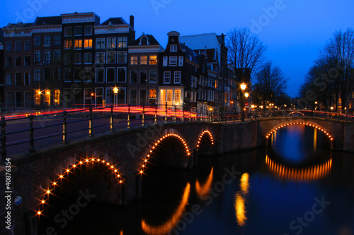 Photo Amsterdam Canal at Dusk with Light Trails